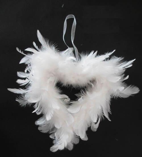 Coeur en plume blanc