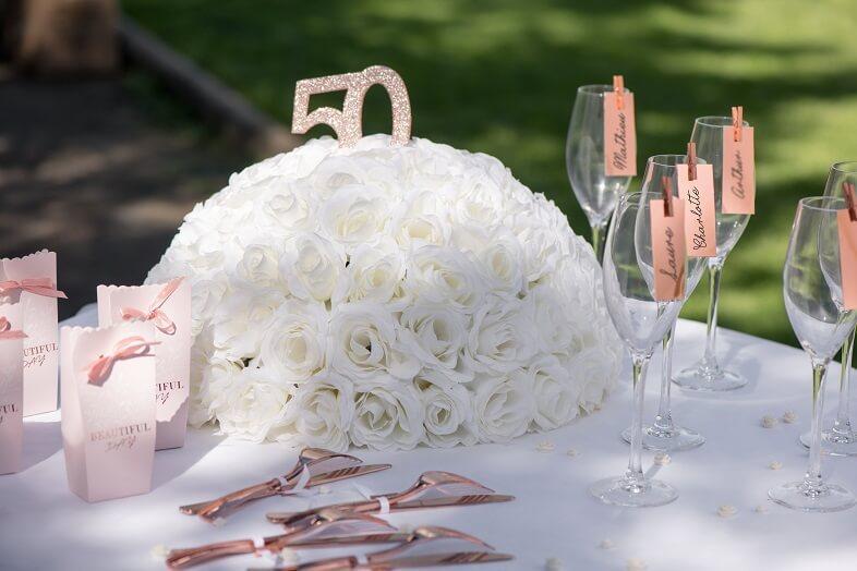 Decoration anniversaire rose gold 50ans avec centre de table