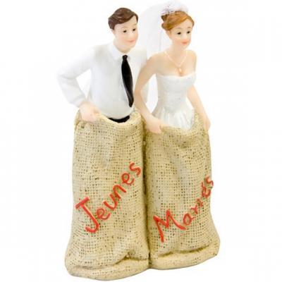 Figurine mariage: Course en sac jeunes mariés (x1) REF/SUJ4975