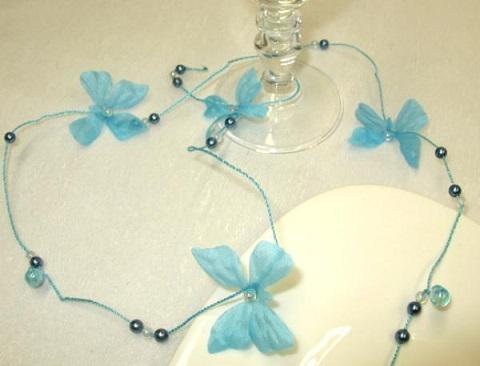 Guirlande papillon et perles bleu turquoise
